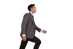 Концепция гоноров с лестницами бизнесмена взбираясь Стоковые Фото