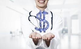 Концепция делать денег представила женской выставкой работника медицины Стоковое Изображение RF