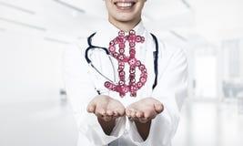 Концепция делать денег представила женской выставкой работника медицины Стоковые Изображения