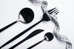 Концепция диеты, черная вилка и измеряя лента Стоковая Фотография