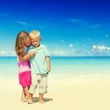 Концепция детей наслаждения потехи семьи пляжа лета Стоковые Фото