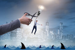 Концепция дела с лампой и бизнесменом Стоковое Фото