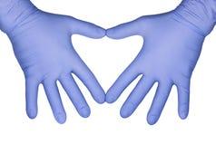 Концепция здравоохранения: руки в голубых медицинских перчатках латекса Стоковое фото RF