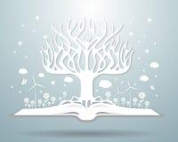 Концепция зимы экологичности, бумажное дерево растя от открытой книги Стоковое фото RF
