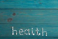 Концепция здоровья - пилюльки на таблице Стоковое Изображение RF
