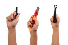 Концепция игрушки инструмента инженера Рука мальчика держа гайку болта винта, резец и ключ забавляются инструменты Стоковые Изображения