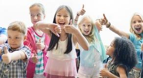 Концепция изменения ребеят школьного возраста жизнерадостная Стоковое фото RF