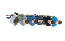 Концепция команды - мальчики и девушки университетской спортивной команды стоят один другого Стоковое Фото