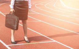 Концепция конкуренции дела на следе бизнесмены стоять Стоковое Изображение