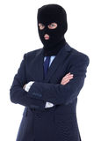 Концепция коррупции - человек в деловом костюме и черном изоляте маски Стоковые Изображения