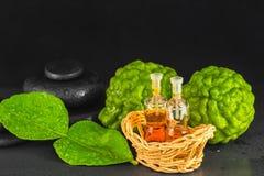 Концепция курорта бергамота, лист, масла благоуханием и базальта Дзэн Стоковая Фотография