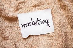 Концепция маркетинга на белой бумаге с предпосылкой старого стиля Стоковое Изображение RF