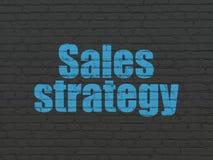Концепция маркетинга: Стратегия продаж на предпосылке стены стоковое изображение