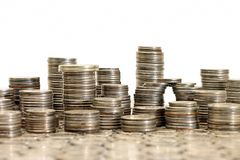 Концепция материализма - города сделанного монеток Стоковые Изображения RF
