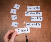Концепция мотивировки собственной личности Отрицательные слова отрезанные с ножницами Стоковая Фотография RF