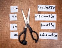 Концепция мотивировки собственной личности Отрицательные слова отрезанные с ножницами Стоковые Изображения RF