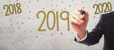 концепция 2019 Новых Годов с бизнесменом стоковые изображения rf