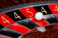 Концепция номеров рулетки казино удачливых катит черный и красный sec Стоковое Изображение