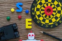 Концепция оптимизирования поисковой системы SEO с карандашем, dartboard, m Стоковое Изображение