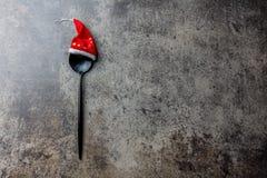 Концепция предпосылки еды рождества праздника Концепция меню рождества Ложка столового прибора с украшением рождества, камнем Стоковое Фото