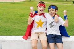 Концепция приятеля друга детей супергероев Стоковое фото RF