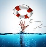 Концепция спасения - спасательный пояс для того чтобы помочь бизнесмену Стоковые Изображения