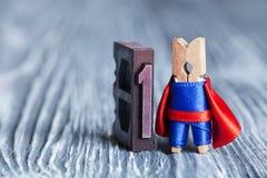 Концепция супергероя руководителя Супергерой зажимки для белья и 1 одно написанные с покрашенным винтажным letterpress мягкий фок Стоковые Изображения