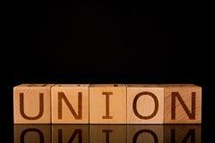 """Концепция сыгранности, деревянный блок куба с  """"UNION†слова стоковые изображения rf"""