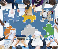 Концепция сыгранности команды соединения мозаики корпоративная Стоковая Фотография