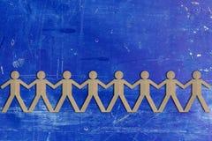Концепция сыгранности, отрезок группы людей бумажный вне Стоковое Изображение RF