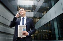 Концепция телефона бизнесмена работая говоря Стоковые Изображения RF