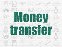Концепция финансов: Денежный перевод на предпосылке стены Стоковое фото RF
