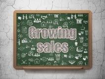 Концепция финансов: Растущие продажи на предпосылке школьного правления Стоковое фото RF