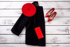 Концепция черной и красной женщины зимы одевает Стоковые Фото