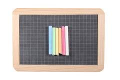 Концепция школы: закройте вверх на классн классном шифера изолированном на белой предпосылке с мел и путем клиппирования Стоковое фото RF