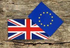 Концепция Brexit, голубой Европейский союз EC и флаги Великобритании Стоковое Фото