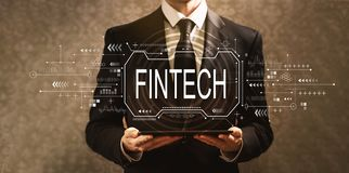 Концепция Fintech с бизнесменом стоковое фото rf