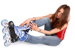 коньки ролика девушки стоковое изображение rf
