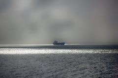 Корабль далеко вне к морю Стоковая Фотография