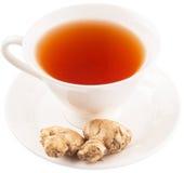 Корень имбиря и чашка чаю v Стоковые Изображения