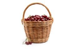 Корзина вполне свежей красной вишни на белой предпосылке Стоковая Фотография