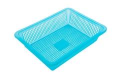 Корзина голубого цвета пластичная на белой предпосылке Стоковая Фотография