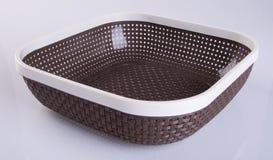 корзина или пустая пластичная корзина на предпосылке Стоковые Изображения RF