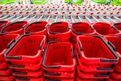 Корзины для товаров и магазинные тележкаи Стоковые Изображения