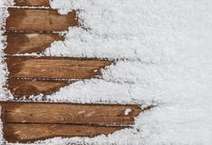 Коричневая деревянная текстура с снегом шелушится над ей Стоковые Изображения