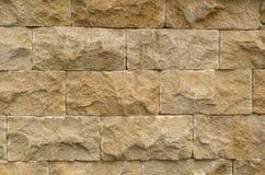 Коричневая каменная предпосылка текстуры стены кирпичей Стоковое Изображение RF