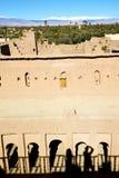коричневая конструкция в Африке Марокко и облаках Стоковая Фотография