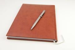 коричневая тетрадь Стоковые Фотографии RF