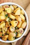 Коричневенные картошки зажаренные в духовке маслом Стоковое фото RF
