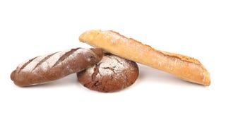2 коричневое и белые хлебы одно. Стоковые Изображения RF